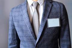 The business man standing with a Blank Badge Stock Images