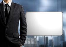 Business man standing and blank white board Royalty Free Stock Image