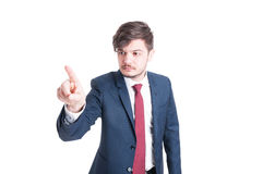 Business man standing browsing invisible screen Royalty Free Stock Image