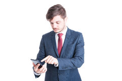 Business man standing browsing smartphone Stock Images