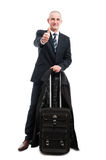 Business man standing with carry on luggage showing like gesture Stock Image