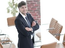 Business man standing in an empty meeting room Stock Image