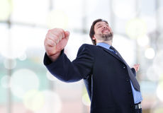 Business man standing with fists clenched Stock Photo