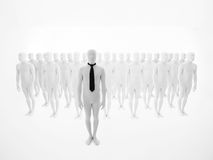 Business man standing in front of an crowd Royalty Free Stock Images