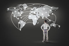 Business man standing in front of world map. Background Royalty Free Stock Photography