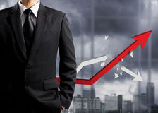 Business man standing with growth chart Stock Photos