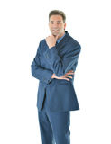 Business man standing with hand on chin. Business man with folded arms looking straight with hand on chin vertical aspect Stock Photography