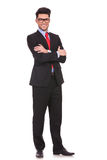 Business man standing with hands folded Stock Image