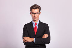 Business man standing with hands folded Royalty Free Stock Photo