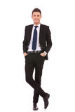 Business man standing with hands in pocket Stock Photos