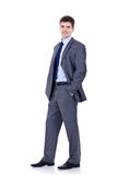 Business man standing with hands in pockets royalty free stock images