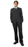 Business man standing - hands in pockets Royalty Free Stock Photography