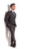 Business man standing with hands in pockets and looks up Royalty Free Stock Photo