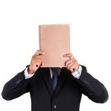 Business man standing and hidden his face Stock Images