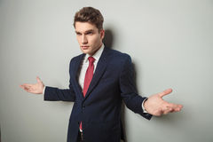 Business man standing with his arms open Stock Photography