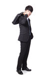 Business man standing and holding briefcase Royalty Free Stock Photo