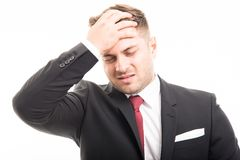 Business man standing holding forehead like hurting Stock Photo