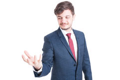 Business man standing and holding something Stock Images