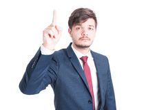 Business man standing with index finger up Stock Images