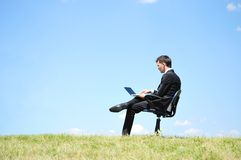Business man standing on laptop Stock Photography