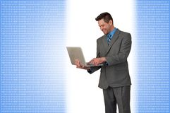 Business Man standing with Laptop stock photo