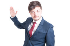 Business man standing looking violent with hand up. Isolated on white background with copy advertising area Stock Photography