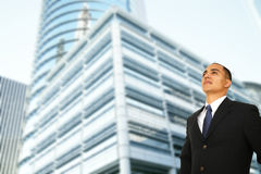 Business Man Standing By Modern Building Stock Photo