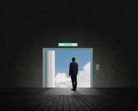 Business man standing near an open door Royalty Free Stock Photography