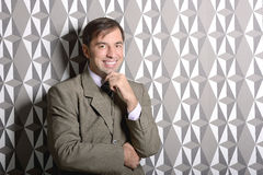 Business man standing near the wall - stock photo Royalty Free Stock Photos