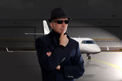 Business man standing next to private jet. Business man standing next to a private jet Royalty Free Stock Photography