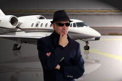 Business man standing next to private jet Royalty Free Stock Photos