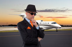 Business man standing next to private jet Stock Photo