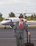 Business man standing next to private jet Royalty Free Stock Images