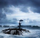 Business man standing ocean waves despair Stock Image