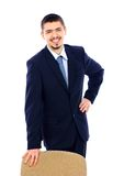 Business man standing with office chair Royalty Free Stock Photo