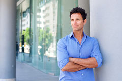 Business man standing outside with arms crossed Royalty Free Stock Photography