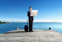 Business man standing on pier whith map Royalty Free Stock Photo