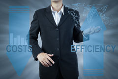 Business man standing and presents cost and efficiency, finance Royalty Free Stock Photo