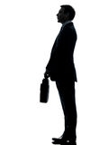 Business man standing proflie silhouette Stock Image