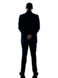 Business man standing rear view isolated Stock Images