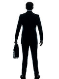 Business man standing rear view silhouette Royalty Free Stock Photo