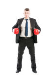 Business man standing with red boxing gloves Stock Photo