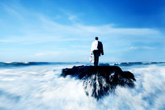 Business Man Standing Rock Ocean Life Buoy Concept Stock Image