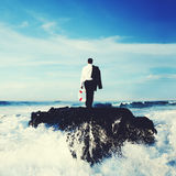 Business Man Standing Rock Ocean Life Buoy Concept Stock Photography