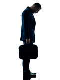 Business man standing sadness silhouette isolated Royalty Free Stock Image