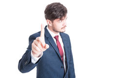 Business man standing showing wait gesture Stock Photos