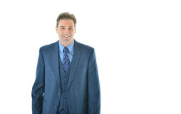 Business man standing with a smile Stock Images