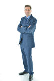 Business man standing with a smile. Successful and happy business man standing with a smile full vertical aspect Royalty Free Stock Photo