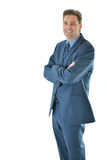 Business man standing with a smile. Successful Business man or salesman with folded arms with a big smile vertical aspect Royalty Free Stock Photo