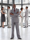 Business man standing smiling with team Stock Photography